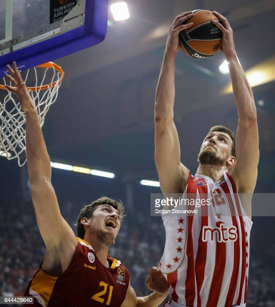 Ognjen Kuzmic of Crvena Zvezda jump for the ball against Tibor Pleiss of Galatasaray during the 2016/2017 Turkish Airlines EuroLeague Regular Season...