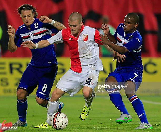 Ognjen Ozegovic of Vojvodina Novi Sad in action against Edgar Barreto and Fernando of Sampdoria during the UEFA Europa League Third Qualifying Round...