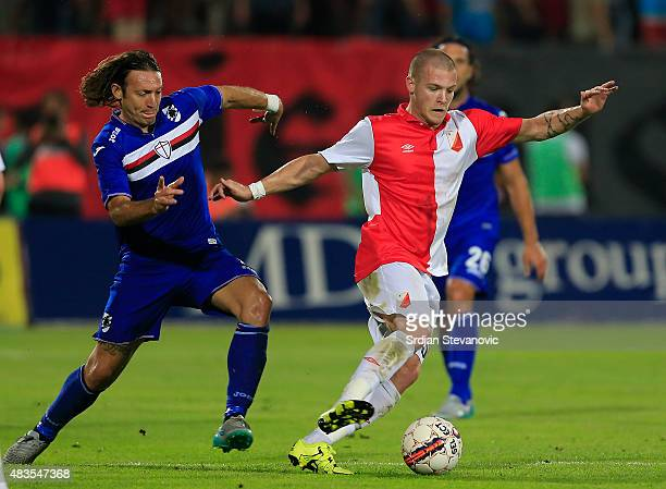 Ognjen Ozegovic of Vojvodina Novi Sad in action against Edgar Barreto of Sampdoria during the UEFA Europa League Third Qualifying Round 2nd Leg match...