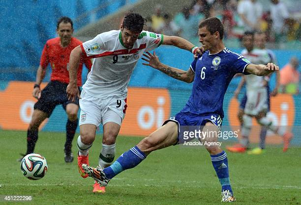 Ognjen Vranjes of BosniaHerzegovina and Alireza Jahan Bakhsh of Iran vie for the ball during the 2014 FIFA World Cup Group F soccer match between...