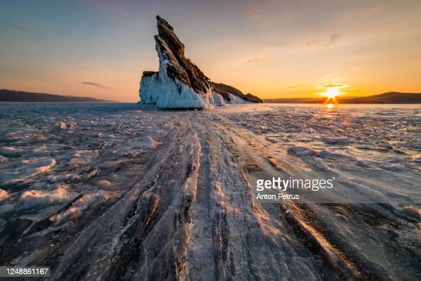 ogoy island at baikal in winter sunrise. siberia, russia - russia stock pictures, royalty-free photos & images