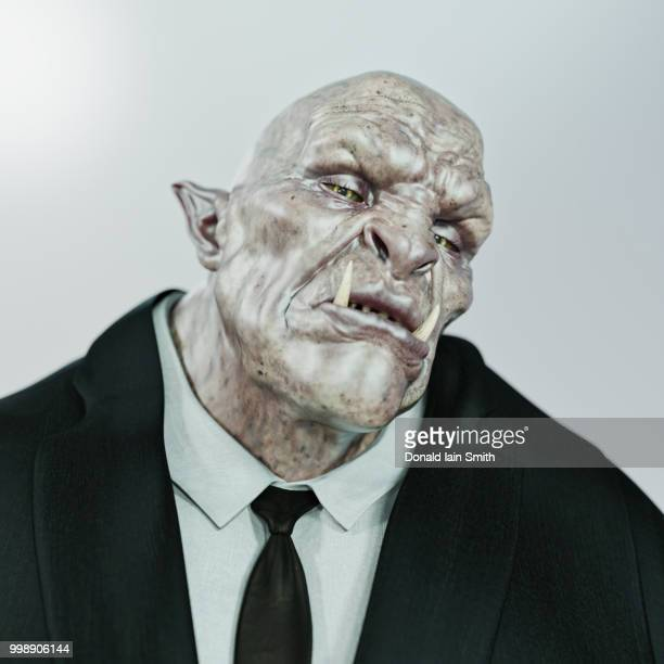 ogre businessman wearing suit and tie - ugly face stock photos and pictures