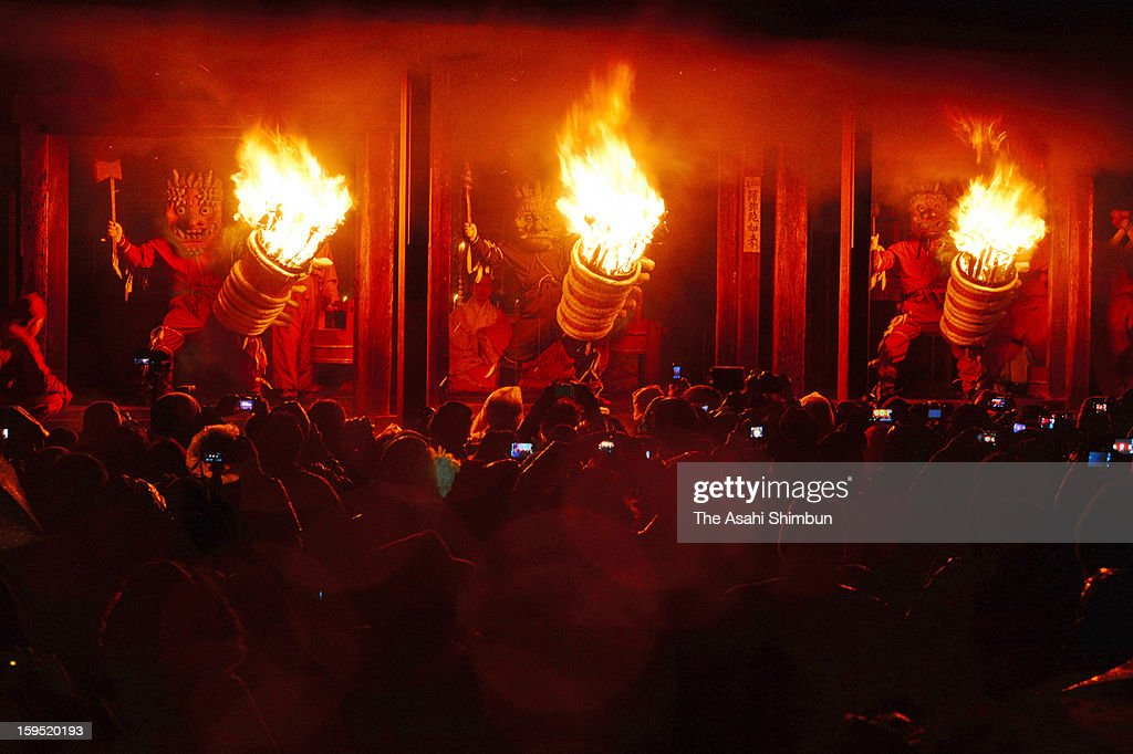ogres holding flaming torches pose the corridor of Dadado, or Dada hall during the Dadado-no-Oni-Hashiri ritual at Nenbutsuji Temple on January 14, 2013 in Gojo, Nara, Japan. The annual event held on January 14 every year, has more than 500 years history, is known as a rare ritual the orges are not symbols of evil, but as the ones to give fortunes and hapiness.
