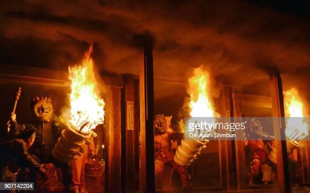 Ogres holding flaming torches pose the corridor of Dadado or Dada hall during the DadadonoOniHashiri ritual at Nenbutsuji Temple on January 14 2018...