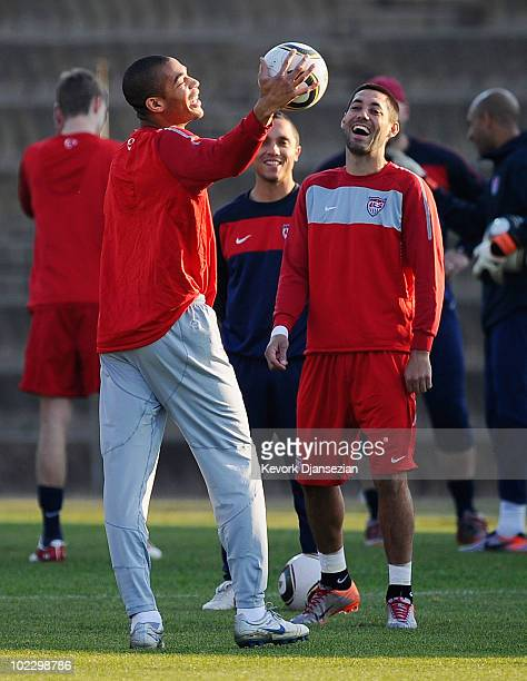 Oguchi Onyewu and Clint Demspey of US national football team smile during training session at Eersterust Stadium on June 22 2010 in Eersterust east...