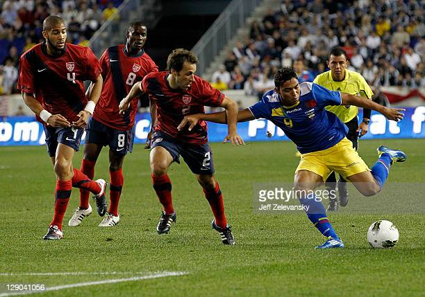 Oguchi Onyewu Maurice Edu and Steve Cherundolo of the United States chase Jefferson Montero of Ecuador during their match at Red Bull Arena on...