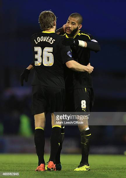 Oguchi Onyewu of Sheffield Wednesday celebrates victory with teammate Glenn Loovens after the FA Cup with Budweiser Fourth Round match between...
