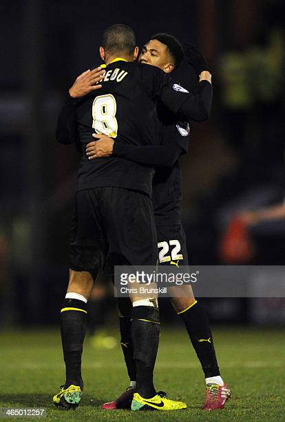 Oguchi Onyewu of Sheffield Wednesday embraces teammate Liam Palmer following the FA Cup with Budweiser Fourth Round match between Rochdale and...