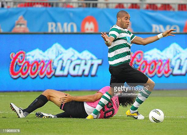Oguchi Onyewu of Sporting Clube De Portugal comes away with the ball as Luca Toni of Juventus FC goes down during their World Football Challenge...