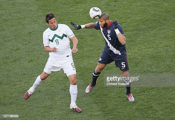 Oguchi Onyewu of the United States challenges Milivoje Novakovic of Slovenia for the ball during the 2010 FIFA World Cup South Africa Group C match...