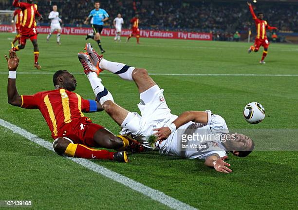 Oguchi Onyewu of the United States clashes with Clint Dempsey of the United States during the 2010 FIFA World Cup South Africa Round of Sixteen match...