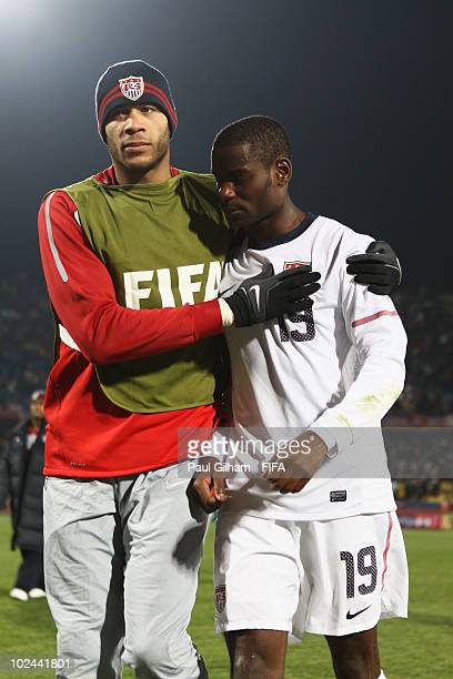 Oguchi Onyewu of the United States consoles dejected Maurice Edu after being knocked out of the tournament after the 2010 FIFA World Cup South Africa...