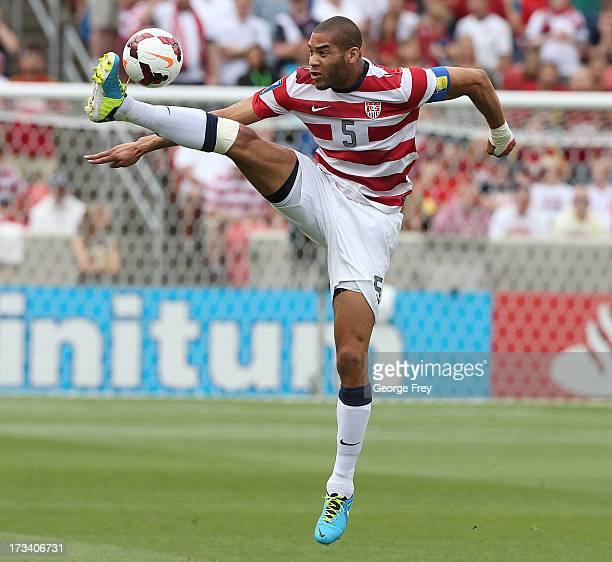 Oguchi Onyewu of the United States controls the ball during a game against Cuba during the first half of an CONCACAF Gold Cup match July 13 2013 at...
