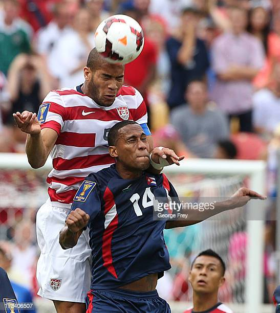 Oguchi Onyewu of the United States heads the ball over Alianni Urgelles of Cuba during the first half of an CONCACAF Gold Cup match July 13 2013 at...