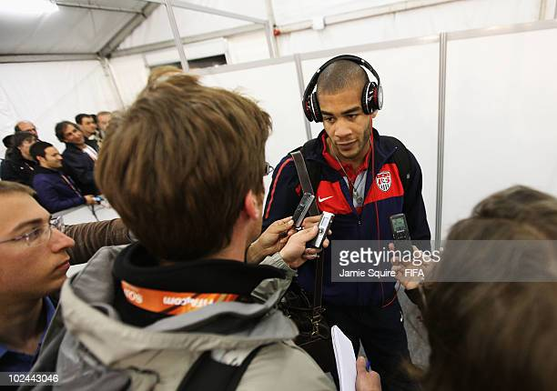 Oguchi Onyewu of the United States listens to questions of the media in the mixed zone after the 2010 FIFA World Cup South Africa Round of Sixteen...