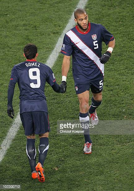 Oguchi Onyewu of the United States shakes the hand of Herculez Gomez as he is substituted during the 2010 FIFA World Cup South Africa Group C match...