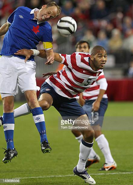 Oguchi Onyewu of USA battles for the ball against Kevin McKenna of Canada during their international friendly match on June 3 2012 at BMO Field in...