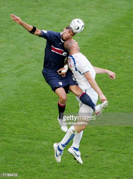 Oguchi Onyewu of USA challenges in the air with Jan Koller of Czech Republic during the FIFA World Cup Germany 2006 Group E match between USA and...