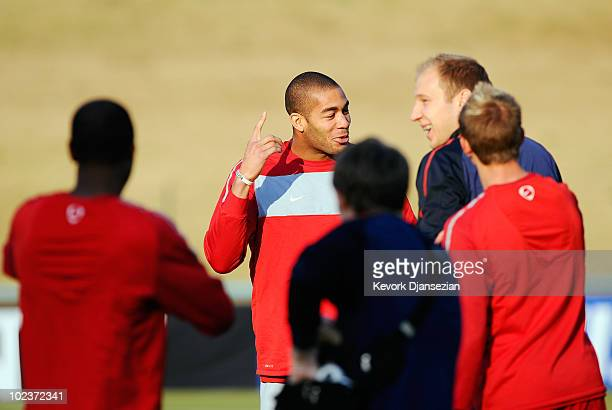 Oguchi Onyewu of USA jokes around with his teammates during training session on June 24 2010 in Pretoria South Africa United States will play their...
