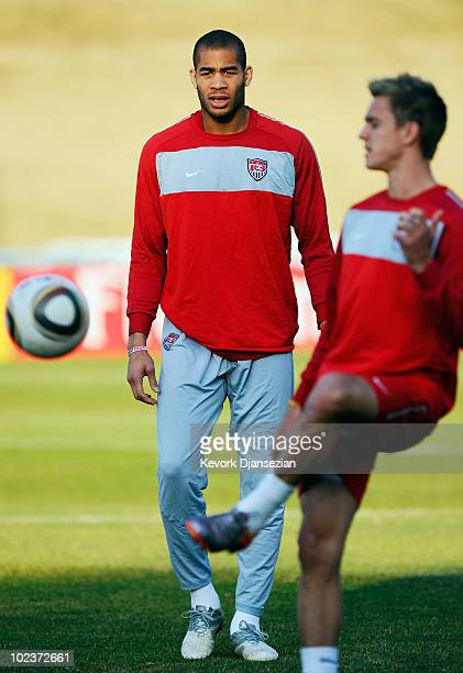 Oguchi Onyewu of USA looks at teammates Stuart Holden during training session on June 24 2010 in Pretoria South Africa United States will play their...
