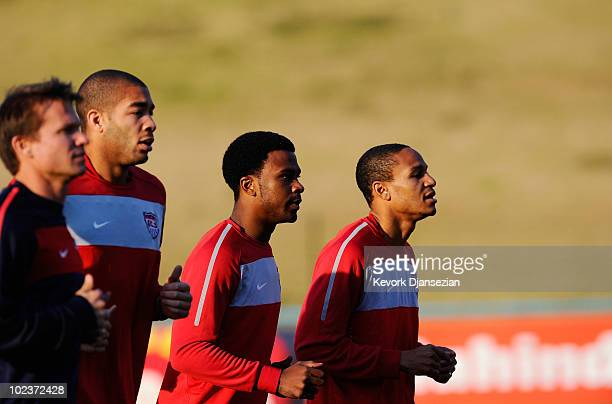 Oguchi Onyewu Robbie Findley and Ricardo Clark of USA warm up during training session on June 24 2010 in Pretoria South Africa United States will...