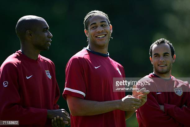 Oguchi Onyewu smiles with Eddie Pope and Landon Donovan during a training session for the United States National Team on June 6 2006 at Edmund...