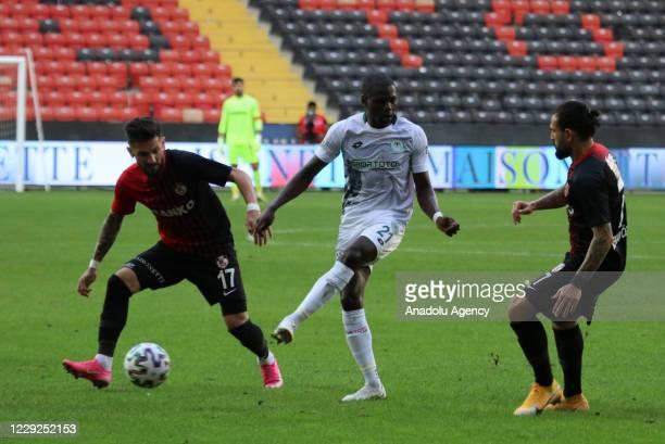 Oguz Ceylan of Gaziantep FK in action against Farouk Miya of Ittifak Holding Konyaspor during Turkish Super Lig match between Gaziantep FK and...