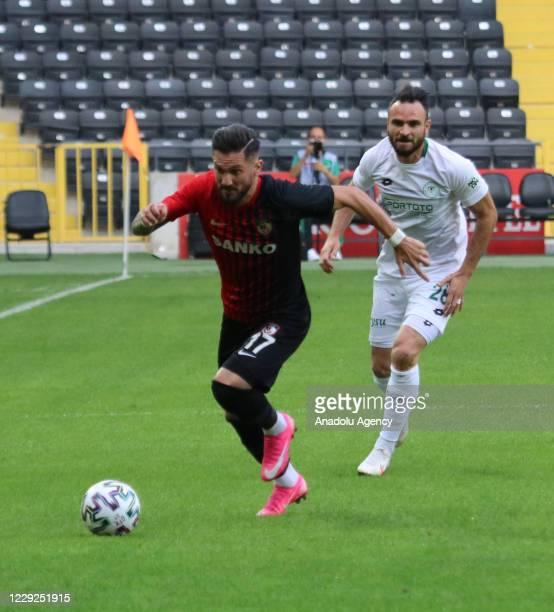 Oguz Ceylan of Gaziantep FK in action against Musa Cagiran of Ittifak Holding Konyaspor during Turkish Super Lig match between Gaziantep FK and...