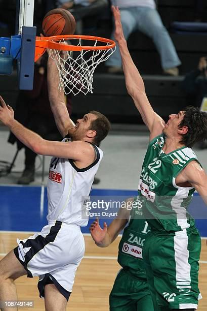 Oguz Savas, #21 of Fenerbahce Ulker Istanbul in action against Boban Marjanovic, #22 of Zalgiris Kaunas during the 2010-2011 Turkish Airlines...