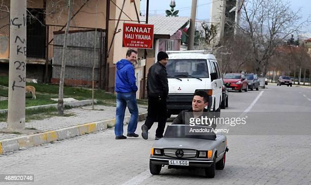 Oguz Yildirim the owner of a limited edition miniature automobile produced in Germany drives his car in Isparta Turkey on April 8 2015 Yildirim has...