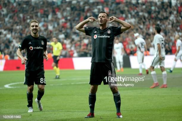 Oguzhan Ozyakup of Besiktas celebrates after scoring a goal during UEFA Europa League play-off second leg match between Partizan and Besiktas at...