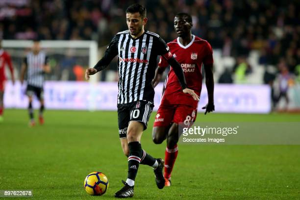 Oguzhan Ozyakup of Besiktas Delvin Ndinga of Sivasspor during the Turkish Super lig match between Sivasspor v Besiktas at the Yeni Sivas 4 Eylil...