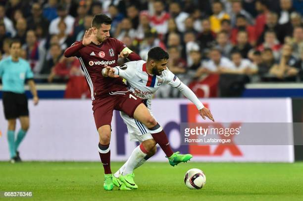 Oguzhan Ozyakup of Besiktas Nabil Fekir of Lyon during the Uefa Europa League quarter final first leg match between Olympique Lyonnais Lyon and...