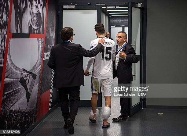Oguzhan Ozyakup of Istanbul leaves the interview zone with ice on his ankles after the UEFA Champions League match between Besiktas JK and SL Benfica...