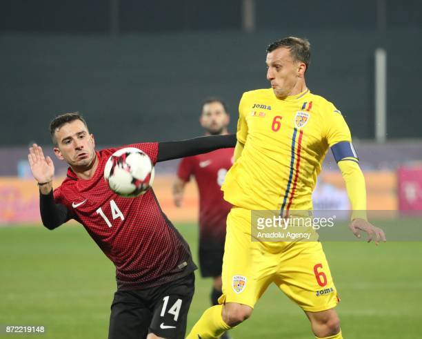 Oguzhan Ozyakup of Turkey in action against Vlad Chiriches of Romania during the friendly match between Romania and Turkey at Dr Constantin Radulescu...