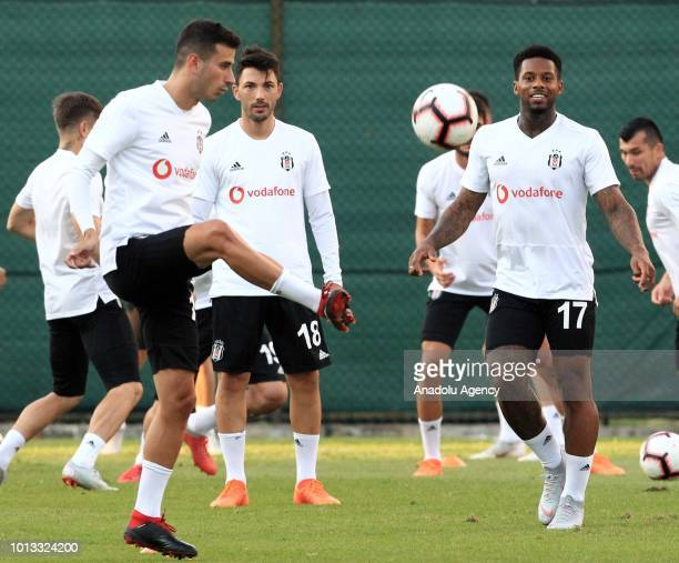 Oguzhan Ozyakup Tolgay Arslan and Jeremain Lens de of Besiktas attend a training session ahead of the UEFA Europa League 3rd Qualifying Round first...