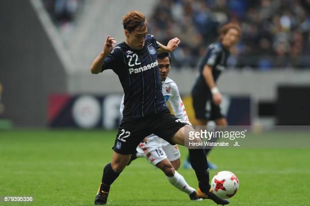 Oh Jae Suk of Gamba Osaka controls the ball under pressure of Chanathip Songkrasin of Consadole Sappporo during the JLeague J1 match between Gamba...