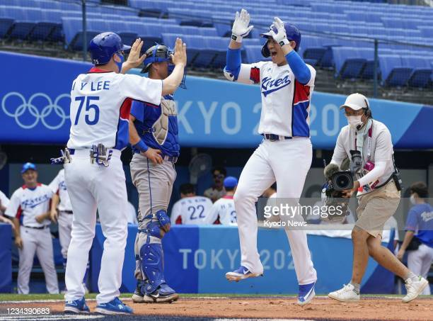 Oh Ji Hwan celebrates as he crosses home plate after hitting a two-run home run in the second inning of South Korea's second-round game against...