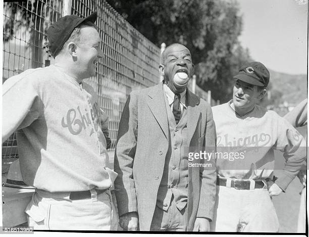 Oh My What a Big Mouth Your Have Says Gabby Hartnett and Elwood English right as they watch Sam Simpson put a regulation baseball into his mouth at...