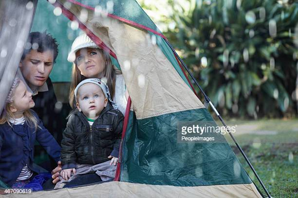 oh no, it's raining! - camping stock photos and pictures