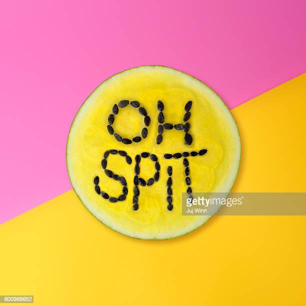 Oh Spit text on slice of yellow watermelon