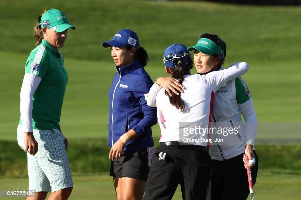 Oh Su and Katherine Kirk of Australia are congratulated by Phoebe Yao and Wei-Ling Hsu of Chinese Taipei after their victory on the 14th green in the...
