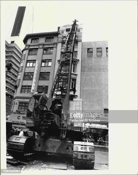 Oh What a balls up This huge wrecking crane with its swinging ball rests against the 'wrong building' in Pitt Street in the heart of Sydney today...