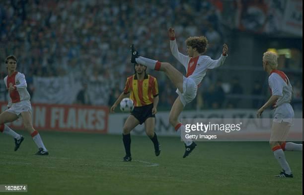 Ohana of Mechelen watches as Verlaat of Ajax high kicks a ball during the European Cup Winners Cup final at the Stade de la Meinau in Strasbourg,...