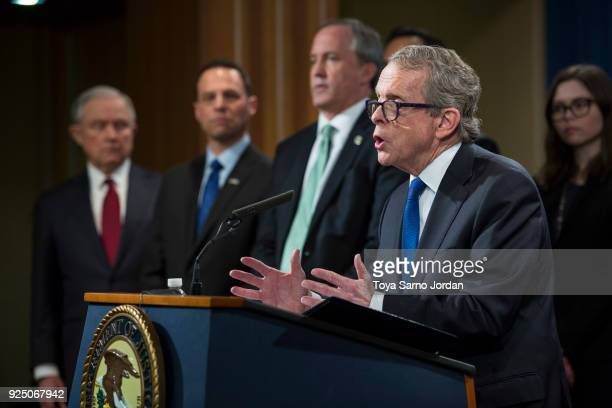 Ohio Attorney General Mike DeWine speaks during a press conference at the Department of Justice in Washington DC on February 27 2018Sessions...