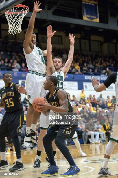 Ohio Bobcats F Doug Taylor and Ohio Bobcats F Kenny Kaminski defend Kent State Golden Flashes G Deon Edwin during the second half of the men's...