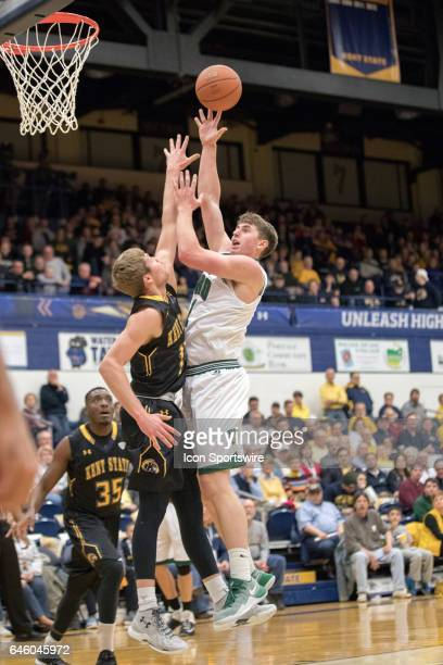 Ohio Bobcats F Jason Carter shoots as Kent State Golden Flashes G Mitch Peterson defends during the first half of the men's college basketball game...