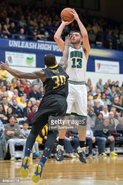 Ohio Bobcats F Kenny Kaminski shoots as Kent State Golden Flashes G Deon Edwin defends during the first half of the men's college basketball game...