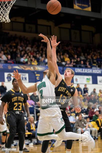 Ohio Bobcats G Jaaron Simmons shoots as Kent State Golden Flashes G Mitch Peterson defends during the second half of the college basketball game...