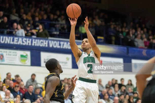 Ohio Bobcats G Jaaron Simmons shoots over Kent State Golden Flashes G Jalen Avery during the first half of the men's college basketball game between...